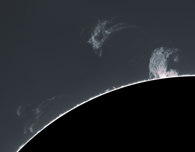 Prominences off a sillhouetted sun