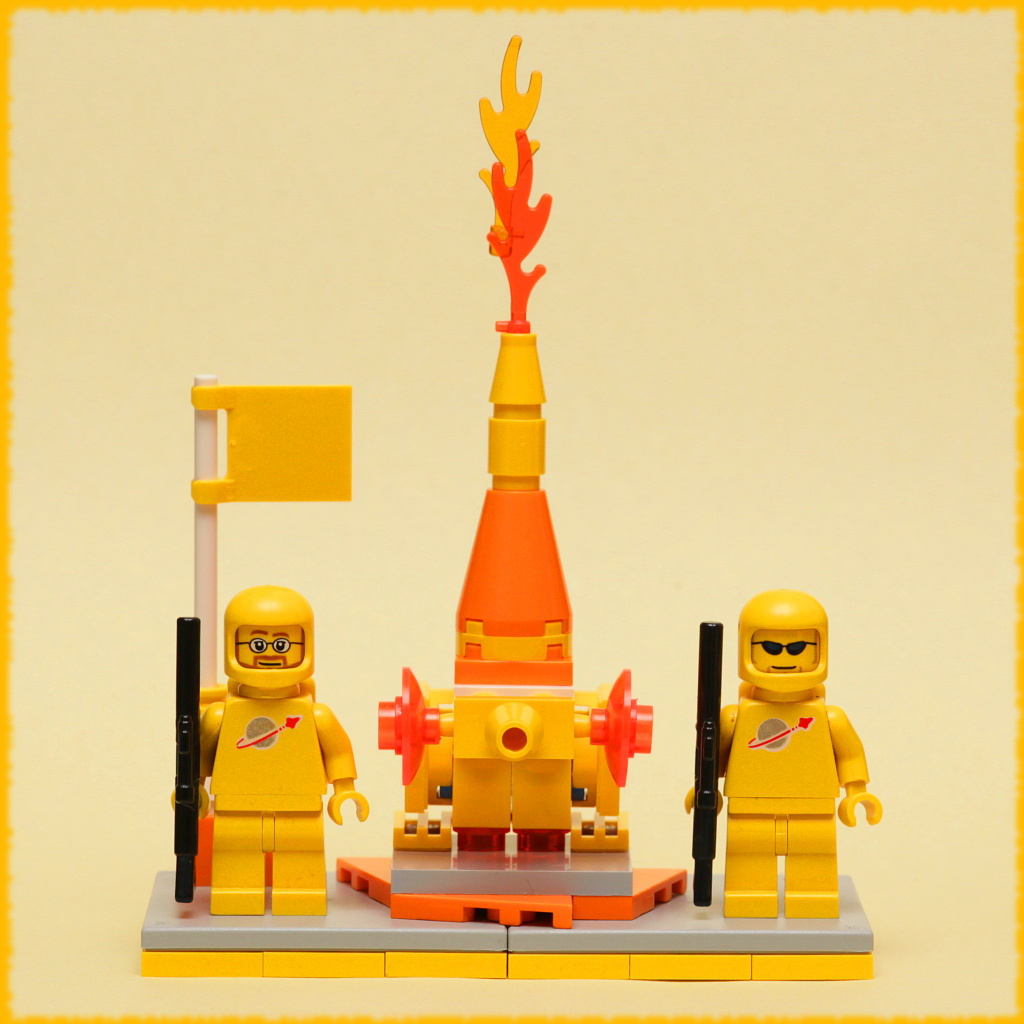 Two lego astronauts with a rocket ship between them
