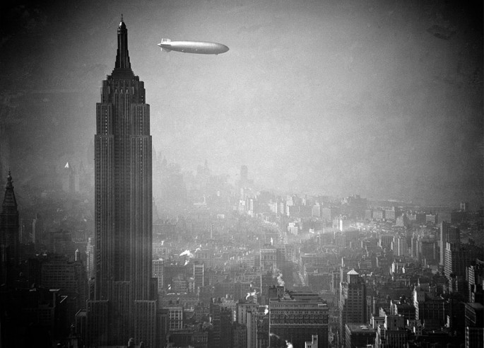 The German zeppelin Hindenburg floats past the Empire State Building over Manhattan - AP Photo