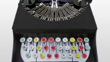 Typewriter with colorful keys