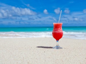 Daiquiri on a beach with blue skies white sand