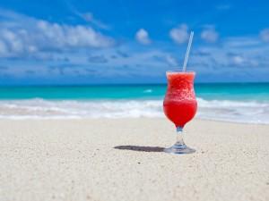 Daiquiri on a beach with blue skies white sand