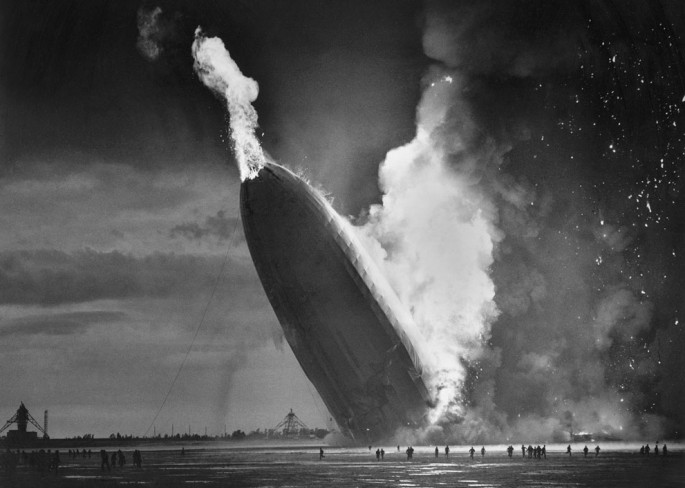 1937 - The German dirigible Hindenburg crashes and killed 36 people - AP Photo/Murray Becker