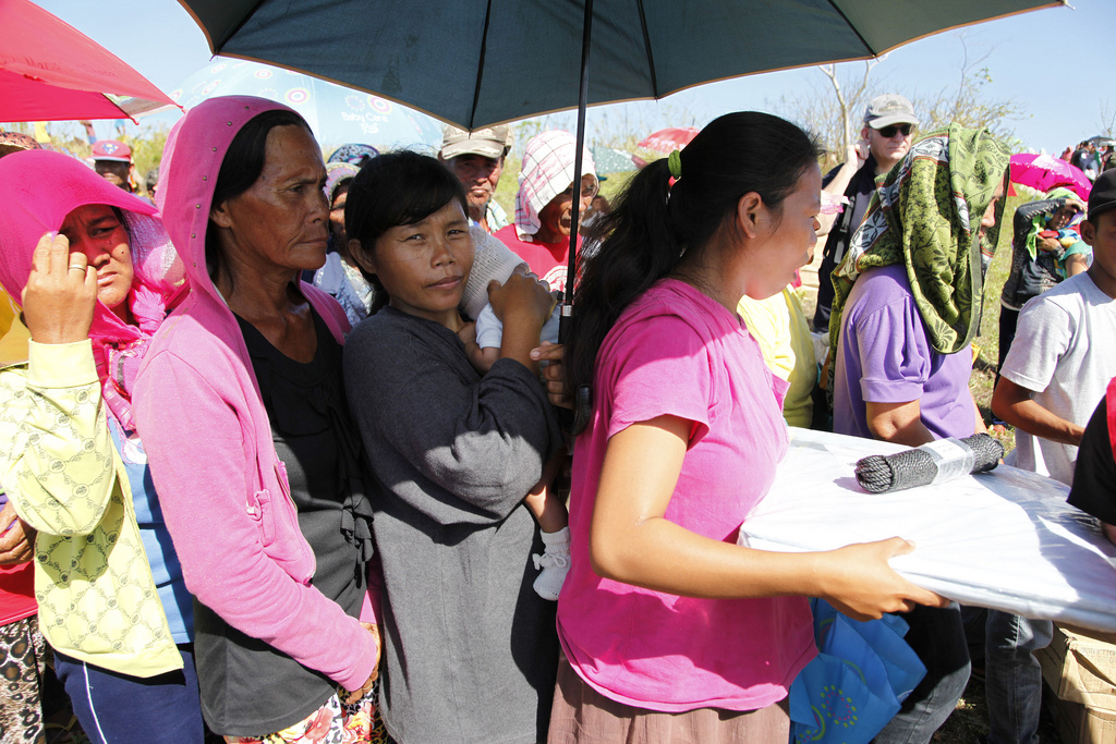 Aid being distributed to mothers affected by Typhoon Haiyan in the Philippines - image by the UK Department for International Development