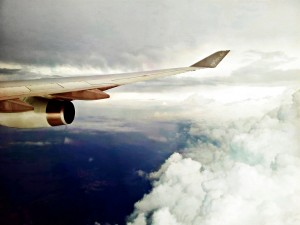 Airplane wing in flight among clouds