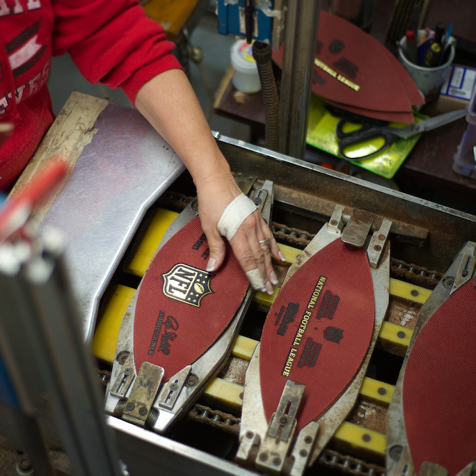 Picture of the Wilson factory making NFL footballs