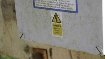 Sign that says, Danger electric shock risk