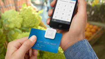 Square register swiping credit card at food market