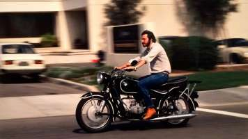 Portrait of Steve Jobs riding a motorcycle on Apple's campus, by Charles O'Rear, American Cool exhibit, Smithsonian Portrait Gallery