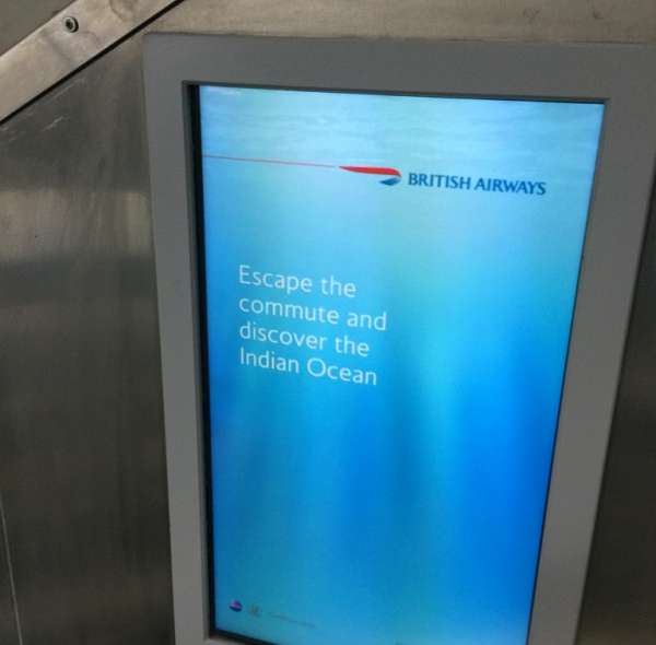 "British airways ad that reads, ""Escape the commute and discover the Indian Ocean"""