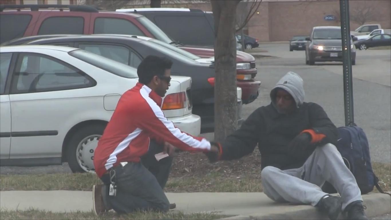 screencap of video of homeless man winning the lottery