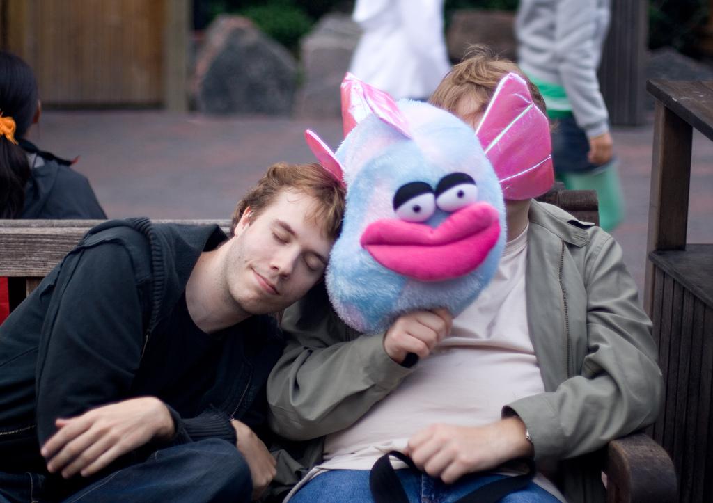 man fallen asleep on a stuffed fish