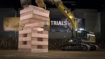 screencap from the world's biggest jenga game played with cat equipment