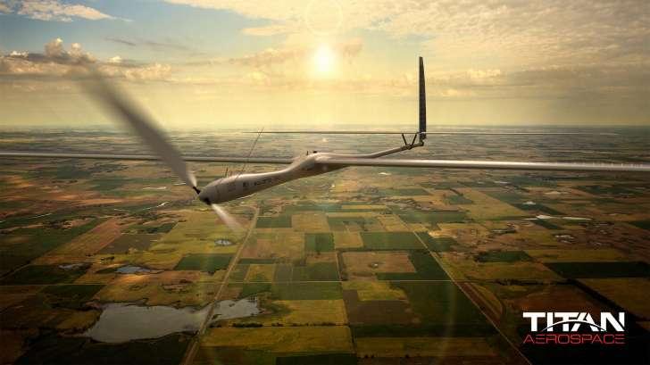 titan aerospace drone flying above land