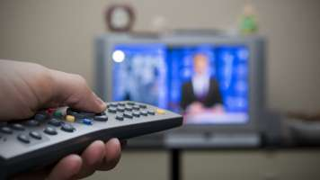 remote control pointed at a tv