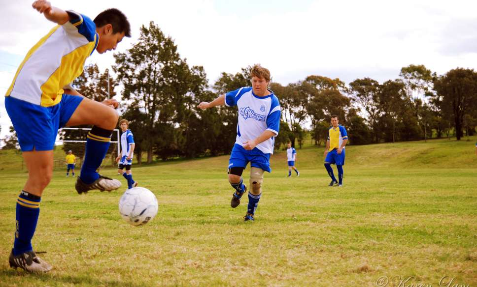 soccer action shot by karjiayu